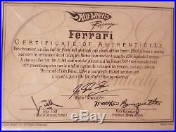 Michael Schumacher 118 Ferrari with piece of actual race suit and signed COA