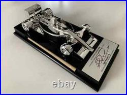 Signed Limited Edition of 130 pieces Nigel Mansell Signed Ferrari 640 1/18 Model